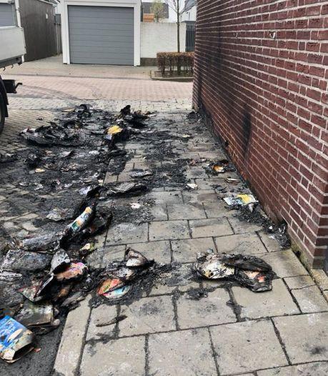 Containers in brand gestoken in Fijnaart, schade aan muur en wegdek