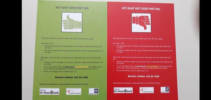 Mensen kunnen een kaart achter hun raam zetten om aan te geven of het goed of slecht gaat. De groene kant naar voren betekent 'goed', de rode kant naar voren slecht.