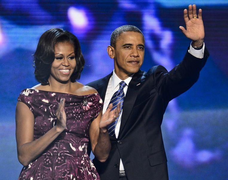 2012-09-06 CHARLOTTE, VS - President Barack Obama en zijn vrouw Michelle Obama zwaaien tijdens de laatste avond van de Democratische Nationale Conventie in Charlotte.  Obama heeft de nominatie voor zijn herverkiezing als president aanvaard. EPA TANNEN MAURY Beeld EPA