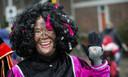 Een zogenaamde roetpiet bij de intocht van Sinterklaas in Amsterdam, vorig jaar.