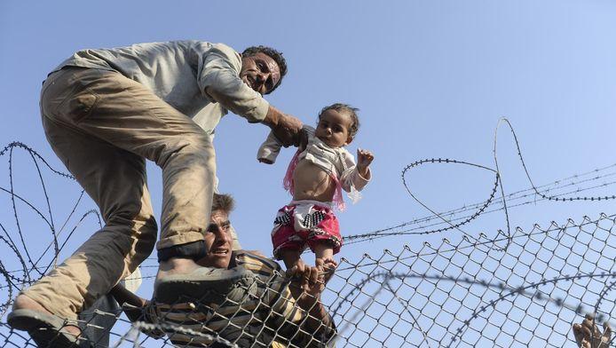 Syrische vluchtelingen bij de Turkse grens