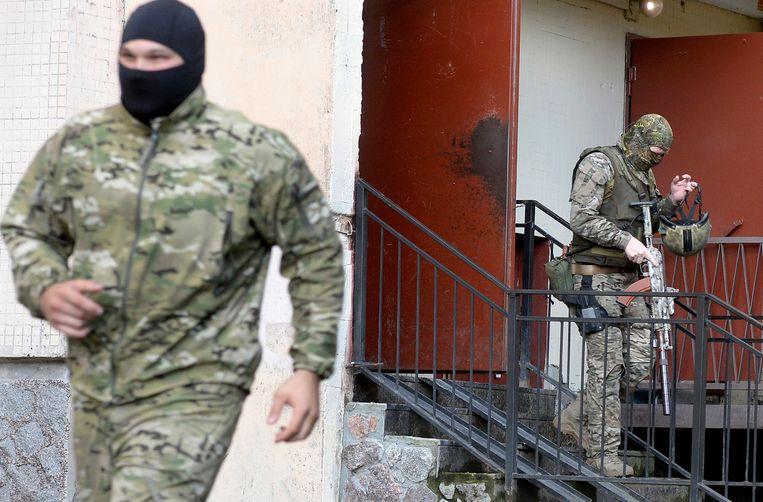 Foto ter illustratie. Russische speciale eenheden na een inval.