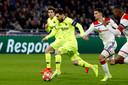 Lionel Messi in actie tegen Olympique Lyon.