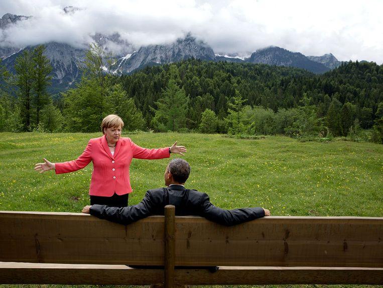 'Met Obama was ze in het begin geen beste maatjes, maar bij zijn afscheids ronde door Europa riep hij de Duitsers zowat op om voor haar te stemmen.'  Beeld Photo News