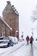 De gevangenenpoort in Megen in de sneeuw