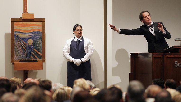 De veiling van De Schreeuw, woensdagavond bij Sotheby's in New York. Beeld getty