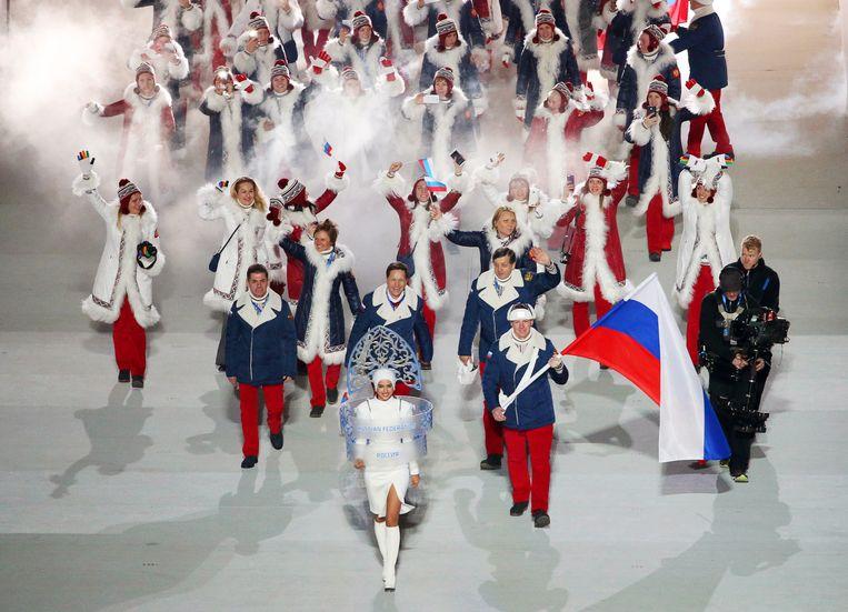 Het Russische sportteam tijdens de openingsceremonie van de Olympische Spelen in Sotsji.  Beeld EPA