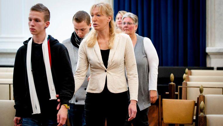 De weduwe en zoons van grensrechter Richard Nieuwenhuizen Beeld anp