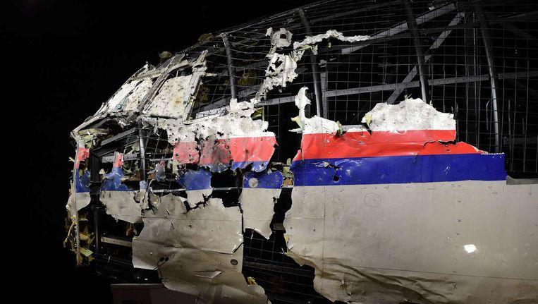 De gehavende romp van vlucht MH17, tentoongesteld tijdens de presentatie van het onderzoeksrapport naar de toedracht van de ramp in oktober 2015 Beeld afp