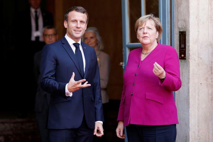 Emmanuel Macron en Angela Merkel tijdens een meeting in Toulouse vorige maand.
