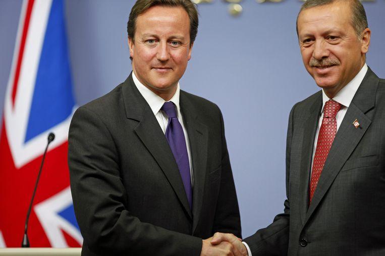De Britse premier David Cameron met de Turkse president Recep Tayyip Erdogan. Beeld epa