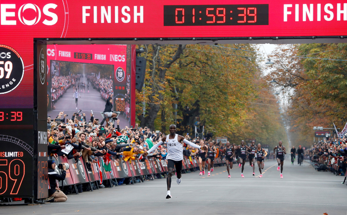 Kenya's Eliud Kipchoge, the marathon world record holder, crosses the finish line during his attempt to run a marathon in under two hours in Vienna, Austria, October 12, 2019. REUTERS/Leonhard Foeger