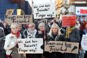 Demonstranten in Hamburg protesteren tegen geweld tegen vrouwen.