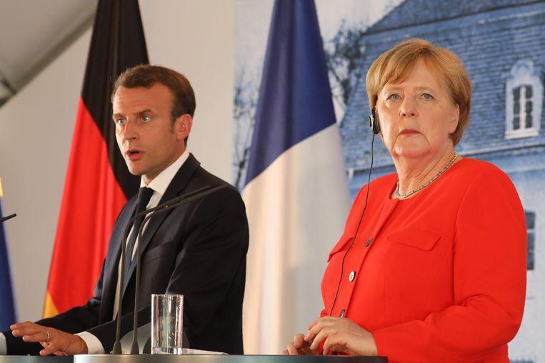 De Franse president Emmanuel Macron en de Duitse bondskanselier Angela Merkel. Beeld AFP