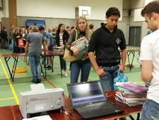 30.000 schoolboeken de container in