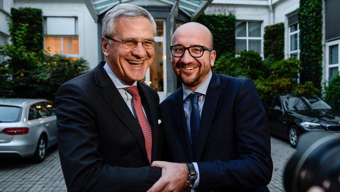 Kris Peeters (links) en Charles Michel (rechts).