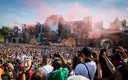 Revelers gather as a DJ performs at the main stage on the first day of the Tomorrowland music festival on July 19, 2019, in Boom. - The 15th edition of Tomorrowland electronic music festival takes place at the 'De Schorre' terrain in Boom from 19 to 21 July 2019 and from 26 to 28 July 2019. (Photo by DAVID PINTENS / BELGA / AFP) / Belgium OUT