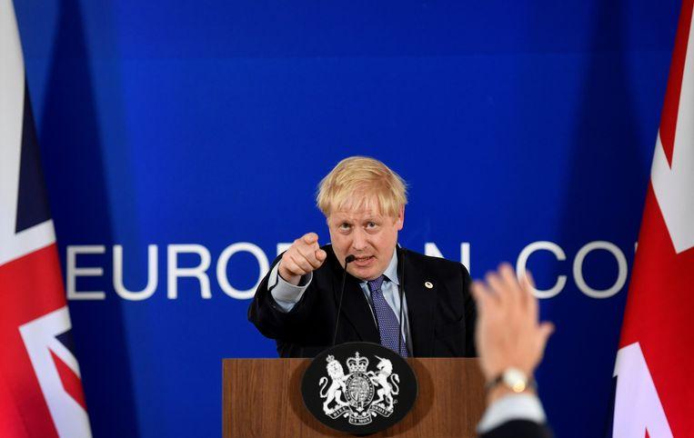 De Britse premier Boris Johnson na de presentatie van het akkoord.  Beeld TOBY MELVILLE/REUTERS