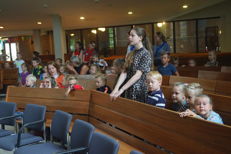 Met de 'Vakantie Bijbel Week' in augustus probeert de kerk in Bunschoten al jaren kinderen aan zich te binden. Beeld Hollandse Hoogte