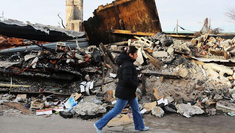 Een door orkaan Sandy verwoest huis in Queens, New York City. Beeld afp