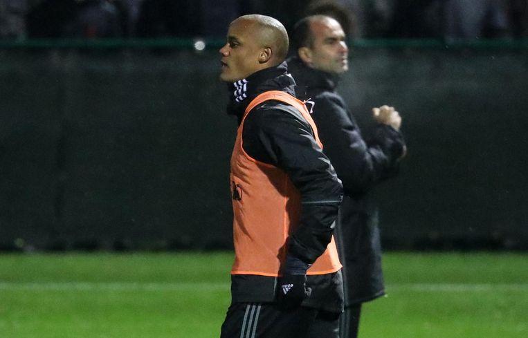Vincent Kompany en coach Roberto Martinez Beeld afp