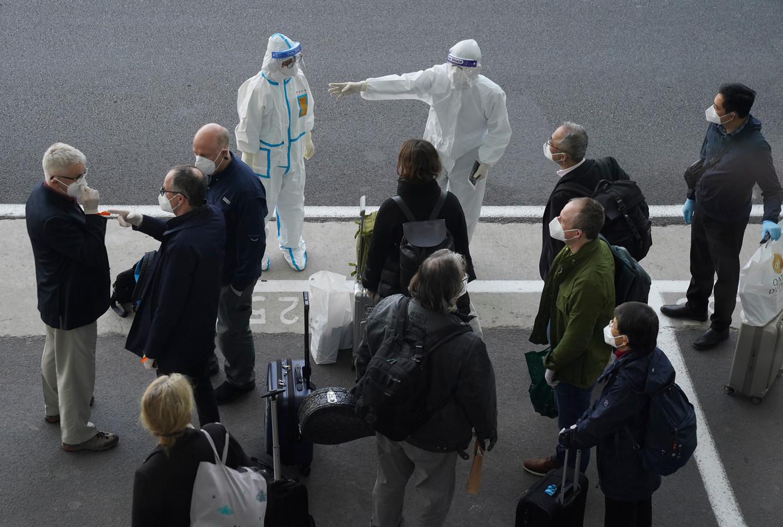 De aankomst van de WHO-delegatie.