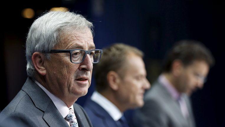 Jean-Claude Juncker (links), Donald Tusk en Jeroen Dijsselbloem tijdens de persconferentie. Beeld REUTERS