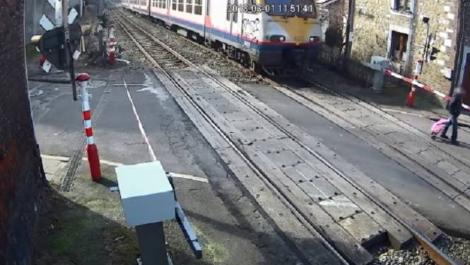 VIDEO: Infrabel deelt beangstigende beelden van spoorloper die op nippertje ontsnapt aan aanstormende trein