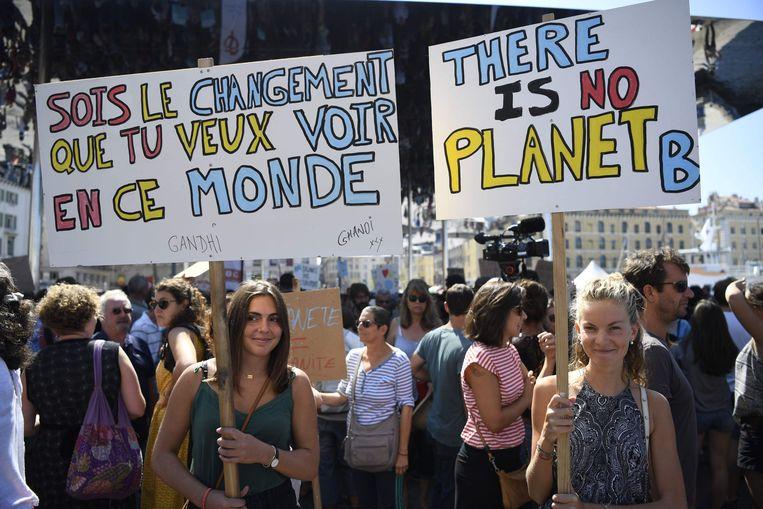 De betogingen vinden wereldwijd plaats.  Beeld AFP