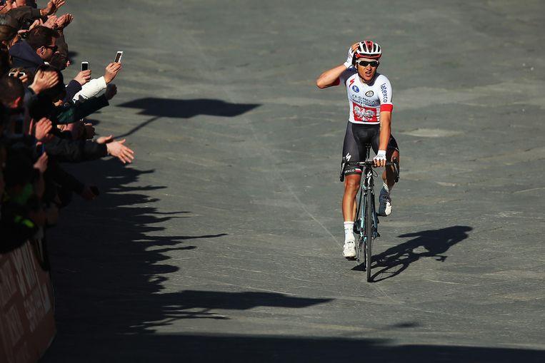 Michal Kwiatkowski rijdt over de finish Beeld null