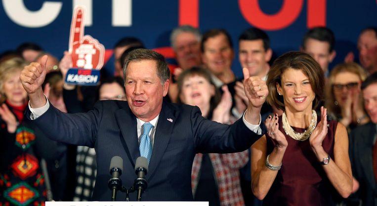 John Kasich en zijn vrouw Karen in New Hampshire. Beeld AP