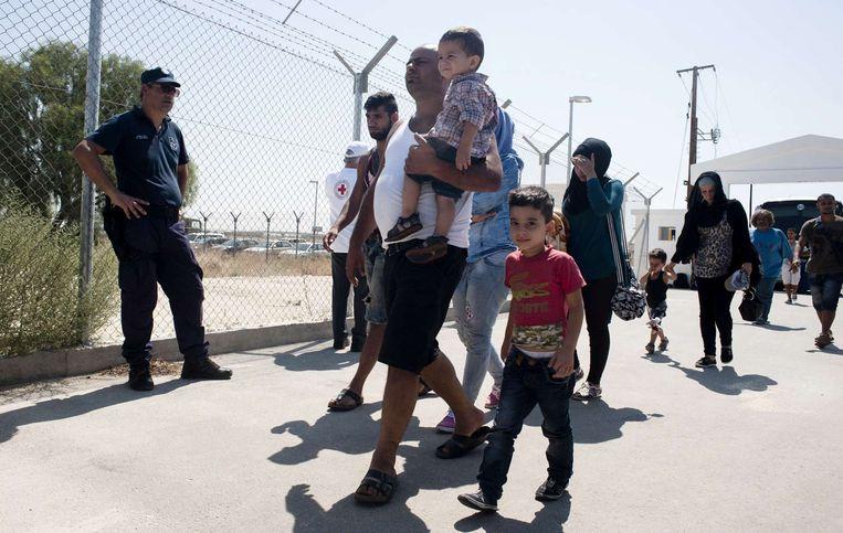 Syrische vluchtelingen arriveren in Nicosia, op het eiland Cyprus. Beeld afp