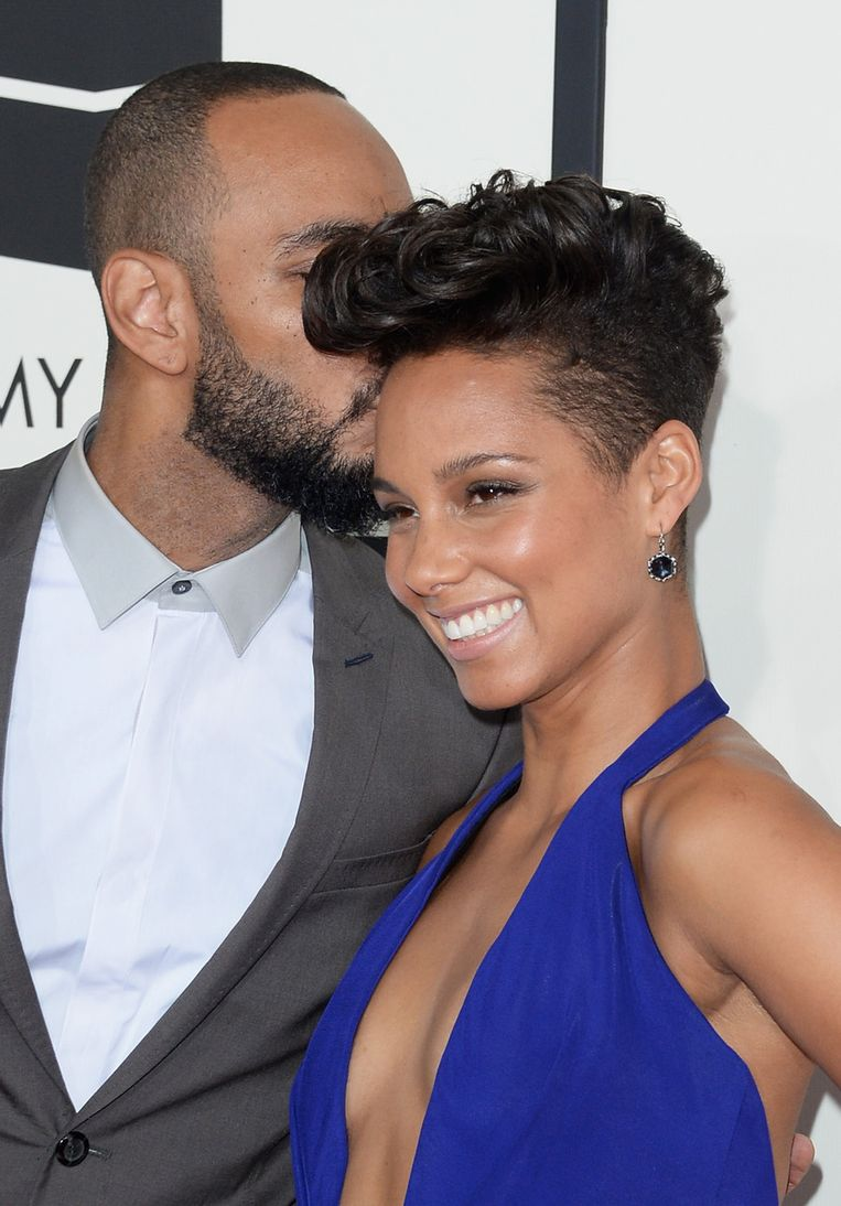 Swizz Beatz (links) en winnares Alicia Keys. Beeld null