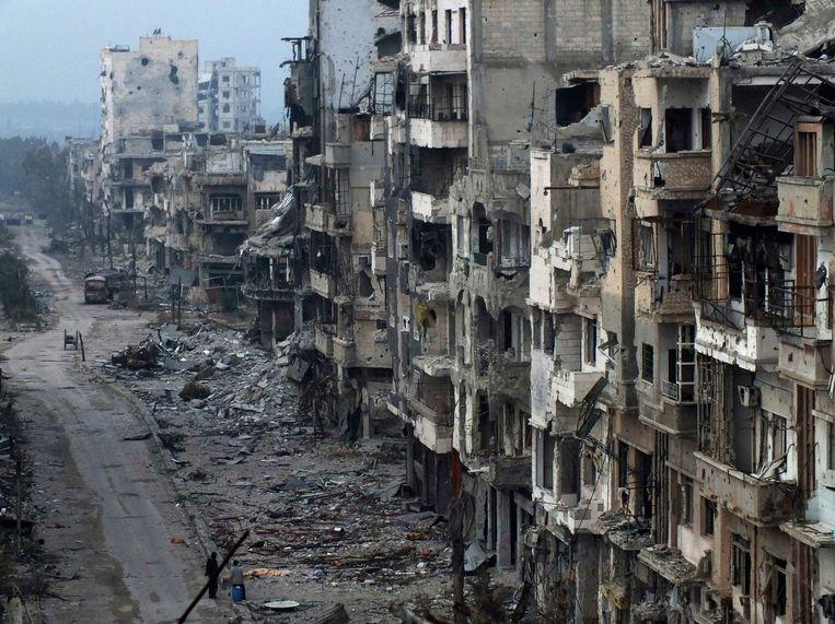 In Homs zijn sommige wijken volledig onbewoonbaar geworden. Beeld REUTERS