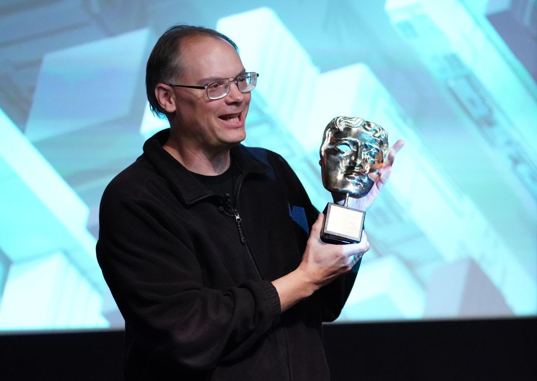 Tim Sweeney, topman van Epic Games, ontvangt een BAFTA-award in 2019 in Londen. Beeld AFP