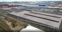 Een simulatie van het enorme parkeergebouw dat AET gaat neerpoten. In een volgende fase kunnen er nog twee parkeertorens volgen.
