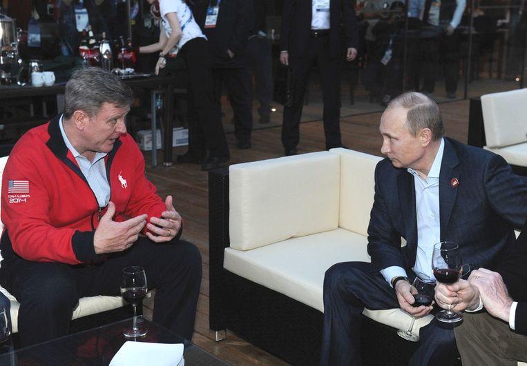 cott Blackmun, algemeen directeur van het Amerikaans Olympisch Comité, en de Russische president Vladimir Poetin. Beeld epa