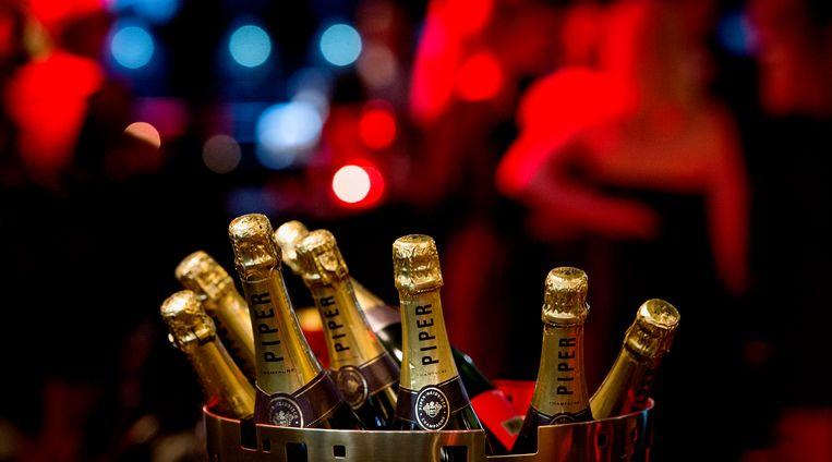 Geen champagne dit jaar bij de miljonairs Beeld ANP Kippa