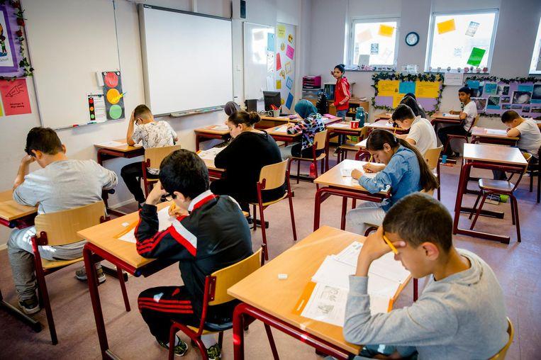 Leerlingen concentreren zich op de Citotoets. Beeld ANP