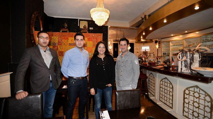 David Boel, Wali, Marjam en Ahmad Alizadah in het restaurant aan de Besterdring
