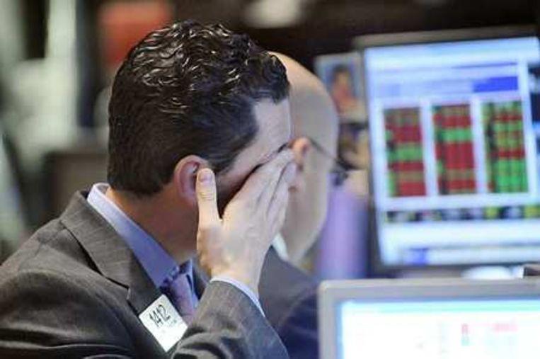 De Dow-Jonesindex in New York onderging woensdag de grootste procentuele daling sinds 1987. Foto AP/Richard Drew Beeld