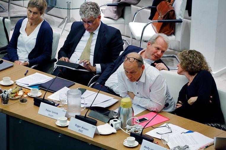 Bijeenkomst van een van de klimaattafels in 2018 met onderhandelaars van onder meer Shell, Nuon, RWE en Energie Nederland. Beeld Hollandse Hoogte / Branko de Lang