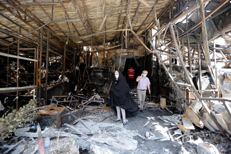 De schade wordt opgenomen na een explosie op 30 juni in een ziekenhuis in Teheran, waarbij 19 doden vielen.  Beeld EPA