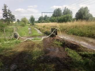 Extra dijk aangelegd en extra pompen geplaatst aan de Kalverbergsite