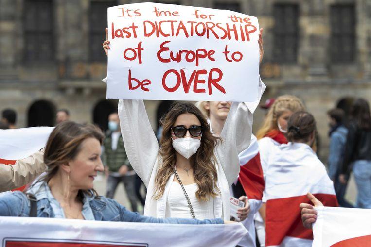 Activisten in Nederland voeren actie tegen het beleid van president Aleksandr Loekasjenko van Wit-Rusland. Beeld ANP