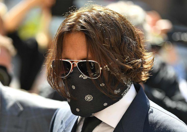 Hollywood-acteur Johnny Depp in Londen betreffende zijn eerste rechtszaak wegens smaad. Beeld AFP