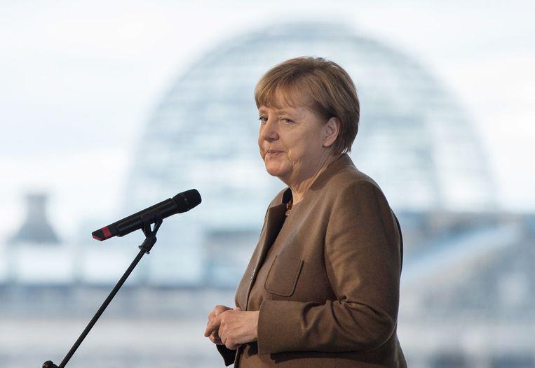 Angela Merkel in Berlijn de dag na afgelasting van de wedstrijd in Hannover Beeld ap