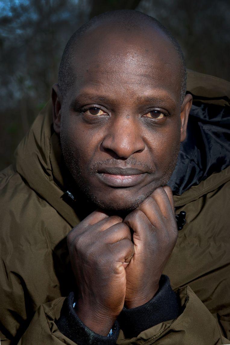 Fred Mukasa diende bij het Internationaal Strafhof een klacht in tegen zijn president. Beeld Maartje Geels
