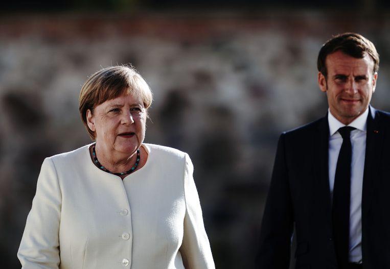 Bondskanselier Angela Merkel en de Franse president Emmanuel Macron. Beeld AFP