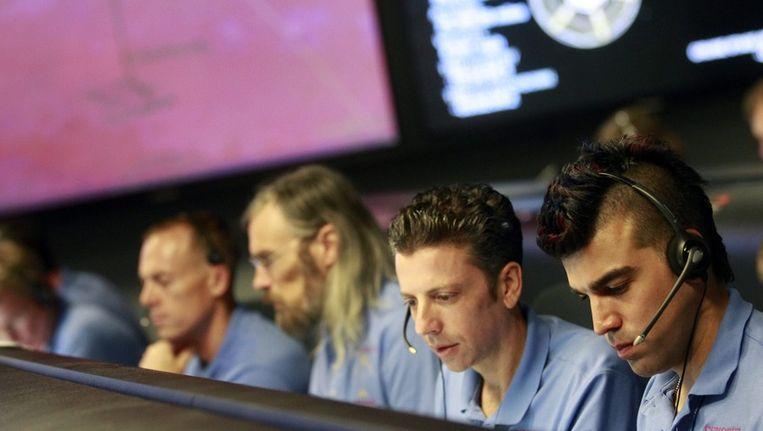 Een aantal leden van Nasa's Curiosity-team, met rechts Bobak Ferdowsi. Beeld afp